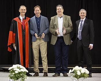 Savage _second from left_ receives UW CSE Alumni Achievement Award